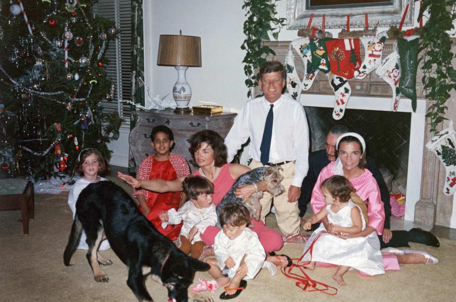 President John F. Kennedy and First Lady Jacqueline Kennedy with their family on Christmas Day at the White House, Washington, D.C., December 25, 1962. (L-R): Caroline Kennedy, unknown, John F. Kennedy Jr., Anthony Radziwill, Prince Stanislaus Radziwill, Lee Radziwill, and their daughter, Ann Christine Radziwill. (Photo courtesy of JFK Library)