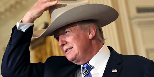"U.S. President Donald Trump wears a cowboy hat as attends a ""Made in America"" products showcase event at the White House in Washington, D.C. on July 17, 2017."