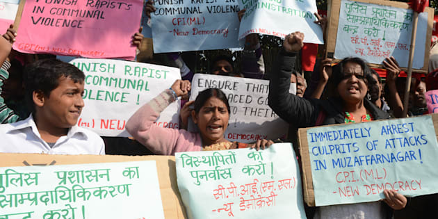 Supporters of the Communist Party of India (Marxist-Leninist) (CPI M-L) shout slogans during a demonstration against a gang rape in Muzaffarnagar, in New Delhi on December 6, 2013.