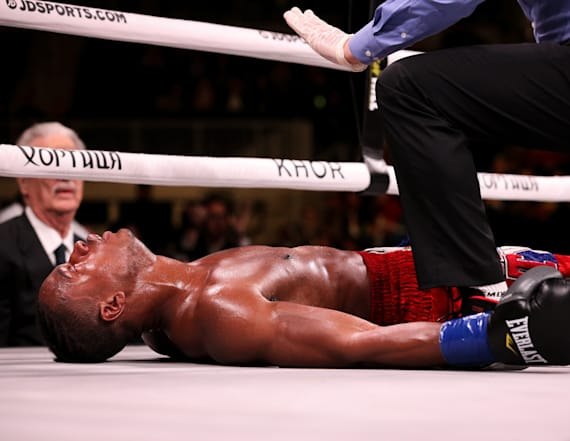 Boxer who was knocked out is 'fighting for his life'