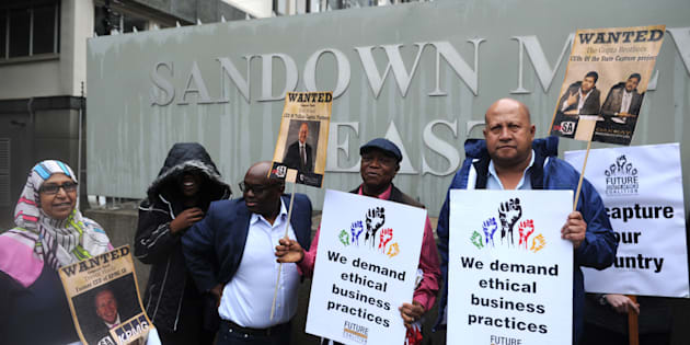 SANDTON, SOUTH AFRICA  OCTOBER 05: (SOUTH AFRICA OUT): Future SA supporters picket outside the McKinsey offices on October 05, 2017 in Sandton, South Africa. The civil society group protested against the way in which the global company conducted itself in relation to its empowerment partner Trillian Capital and their business deals with Eskom. (Photo by Felix Dlangamandla/Foto24/Gallo Images/Getty Images)