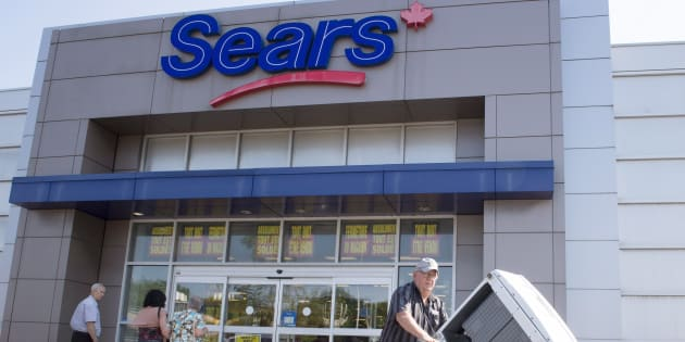 Bargain hunters are seen at the Sears store in St. Eustache, Que. on July 21, 2017, the first day of liquidation sales at 54 Sears locations nationwide.