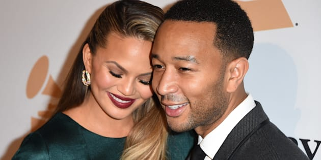 Singer-songwriter  John Legend (R) and his wife Chrissy Teigen arrive for the Clive Davis & The Recording Academy's 2016 Pre-Grammy Gala in Beverly Hills, California, February 14, 2016. AFP PHOTO/ MARK RALSTON / AFP / MARK RALSTON        (Photo credit should read MARK RALSTON/AFP/Getty Images)