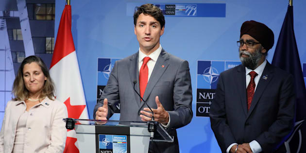 Prime Minister Justin Trudeau, Defence Minister Harjit Sajjan and Foreign Minister Chrystia Freeland hold a news conference after participating in the NATO Summit in Brussels, Belgium on July 12, 2018.