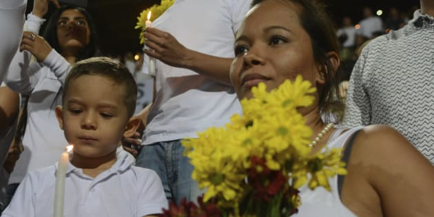 Colombians like this boy and his mother were all supportive of Chapecoense being awarded the Cup.