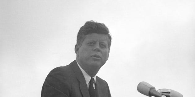 President John F. Kennedy of America acknowledges the cheers of the crowd when he visits New Ross, Co. Wexford, Ireland.