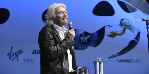 Virgin Group Founder Sir Richard Branson thanks Virgin Galactic workers during the unveiling ceremony of SpaceShipTWO in Mojave, Calif., Feb. 19, 2016. About two dozen affluent Canadians mainly from Ontario and Alberta are among hundreds of people who are in line to become space tourists in the coming months.