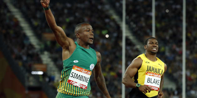 Akani Simbine and Yohan Blake of Jamaica after the men's 100m final at the 2018 Commonwealth Games. REUTERS/Jeremy Lee