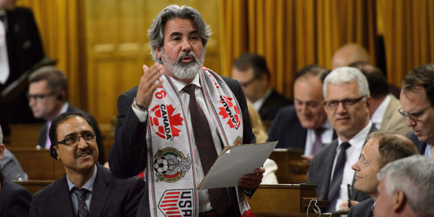 Pablo Rodriguez sports a soccer scarf as he delivers a statement in the House of Commons on June 13, 2018.