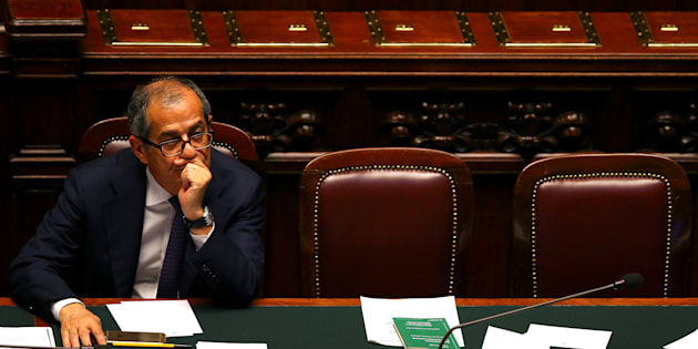 Italian Economy Minister Giovanni Tria attends as Prime Minister Giuseppe Conte (unseen) speaks during his first session at the Lower House of the Parliament in Rome, Italy, June 6, 2018. REUTERS/Tony Gentile