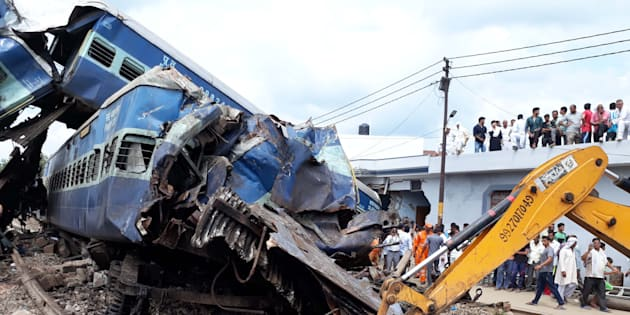 Coaches of the Kalinga Utkal Express train after it derailed in Khatauli.