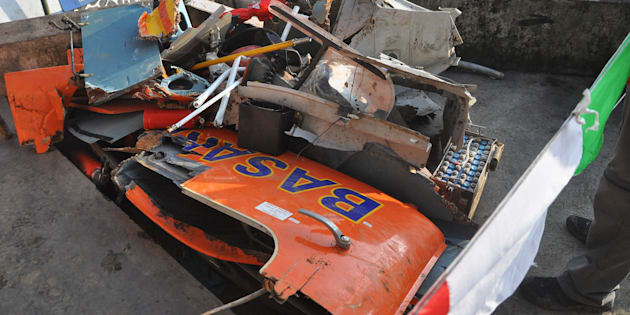 Parts of the wrecked Dauphin AS365 rescue helicopter, which crashed into cliffs just minutes from reaching the site of the erupting volcano, killing all on board.