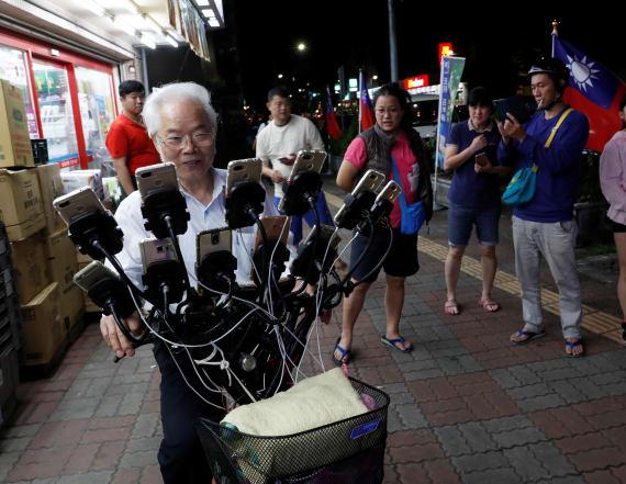 Taiwan grandpa plays Pokemon Go on 15 phones