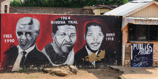 Mural painting illustrating anti-apartheid activist and former president of South Africa Nelson Mandela in the township of Orlando, Soweto.