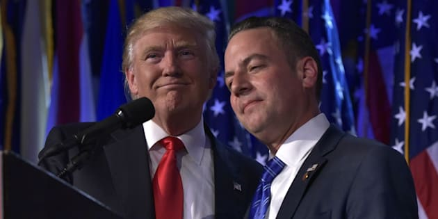 Chairman of the Republican National Committee (RNC) Reince Priebus (R) hugs Republican presidential elect Donald Trump during election night event at the New York Hilton Midtown in New York on November 9, 2016.  / AFP / MANDEL NGAN        (Photo credit should read MANDEL NGAN/AFP/Getty Images)