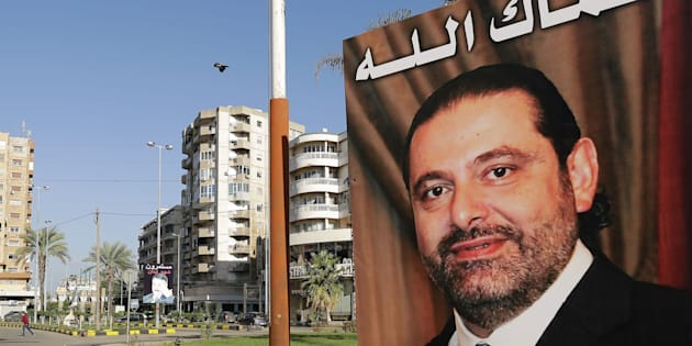 A poster of Lebanese Prime Minister Saad Hariri, with a caption above reading in Arabic: 'God protect you.'