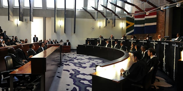 South African Chief justice Mogoeng Mogoeng (2nd from R top row) reads the ruling during the judgment in the matter of Democratic Alliance vs. Speaker of the National Assembly and others at the Constitutional Court in Johannesburg on March 31, 2016.   South Africa's top court delivered a damning verdict against President Jacob Zuma, saying he flouted the constitution over public funds used to upgrade his private residence, sparking immediate calls for him to be impeached. Zuma 'failed to uphold, defend and respect the constitution as the supreme law of the land,' Chief Justice Mogoeng Mogoeng said in a strongly-worded ruling from the Constitutional Court in Johannesburg. / AFP / POOL / felix dlangamandla        (Photo credit should read FELIX DLANGAMANDLA/AFP/Getty Images)