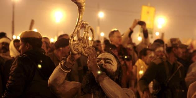 'Naga sadhus' perform rituals on the banks of the Ganga River during the Maha Kumbh festival in Allahabad. (Photo by Mahendra Parikh/Hindustan Times via Getty Images)