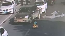 This Child Went For a Joy Ride On A Busy Road in