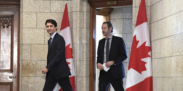 Prime Minister Justin Trudeau leaves his office with his principal secretary Gerald Butts to attend a cabinet meeting on Parliament Hill in Ottawa on April 10, 2018.