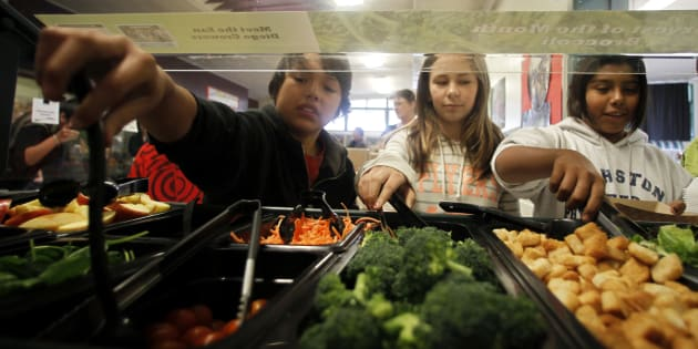 Students get their lunch from a salad bar at the school cafeteria in San Diego, California.