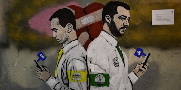 A new mural by Italian street artist TvBoy, entitled 'La Guerra dei Socials' (The War of Social Media), showing Italys Labor and Industry Minister and deputy PM Luigi Di Maio (L) and Italys Interior Minister and deputy PM Matteo Salvini holding mobile phones, is pictured on November 14, 2018 in downtown Milan. (Photo by Miguel MEDINA / AFP) / RESTRICTED TO EDITORIAL USE - MANDATORY MENTION OF THE ARTIST UPON PUBLICATION - TO ILLUSTRATE THE EVENT AS SPECIFIED IN THE CAPTION        (Photo credit should read MIGUEL MEDINA/AFP/Getty Images)