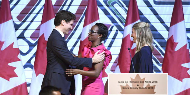 Prime Minister Justin Trudeau is welcomed by Parliamentary Secretary to the Minister of International Development Celina Caesar-Chavannes, as Heritage Minister Melanie Joly looks on, during a Black History Month reception in Gatineau, Que., on Feb. 12, 2018.