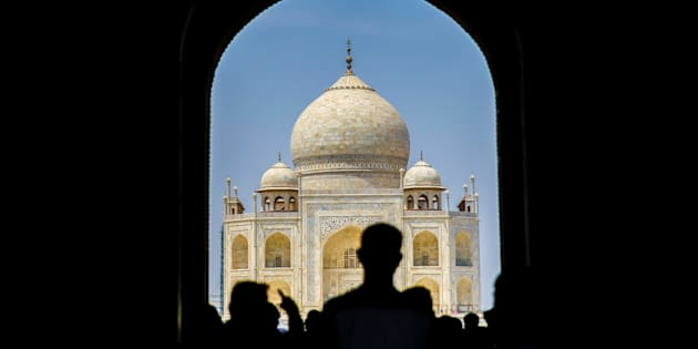 Tourists are seen as renovation process continue at Taj Mahal, one of the wonders of the world, in Agra, India on April 29, 2017.
