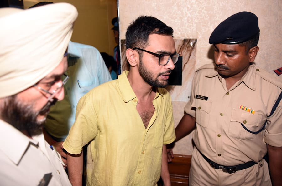 Delhi police officials with JNU student Umar Khalid who escaped unhurt after an unidentified man shot at him, outside the Constitution club at Rafi Marg on August 13, 2018 in New Delhi, India.