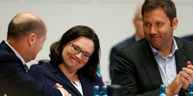 German Finance Minister Olaf Scholz congratulates new SPD leader Andrea Nahles as SPD Secretary General Lars Klingbeil looks on during a one-day party congress of the Social Democratic Party (SPD) in Wiesbaden, Germany, April 22, 2018.   REUTERS/Ralph Orlowski