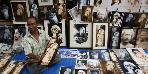 A street vendor in Kolkata sells photographs of Indian poet Rabindranath Tagore on a pavement during celebrations of his 147th birth anniversary.