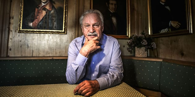 Music composer, DJ and record producer Giorgio Moroder poses next to the portraits of his ancestors in his house on April 18, 2018 in Ortisei, Northern Italy. - Giorgio Moroder will perform as DJ in Los Angeles for his 78th birthday. (Photo by MARCO BERTORELLO / AFP)        (Photo credit should read MARCO BERTORELLO/AFP/Getty Images)