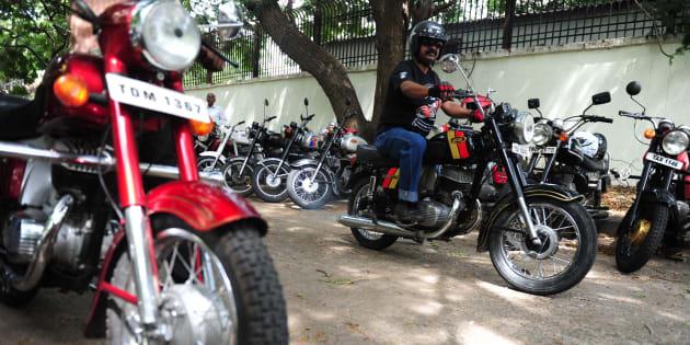 An Indian motorcyclist displays a vintage Yesdi 250 classic motorcycle during a vintage motorcycle exibit in Chennai on July 10, 2016. / AFP / ARUN SANKAR        (Photo credit should read ARUN SANKAR/AFP/Getty Images)