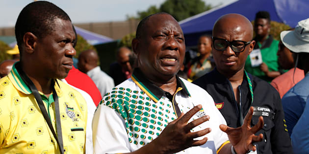 President of the African National Congress (ANC) Cyril Ramaphosa with Paul Mashatile (L) and spokesman Zizi Kodwa address the media at the Nasrec Expo Centre, where the 54th National Conference of the ruling party is taking place in Johannesburg, South Africa December 19, 2017. REUTERS/Rogan Ward