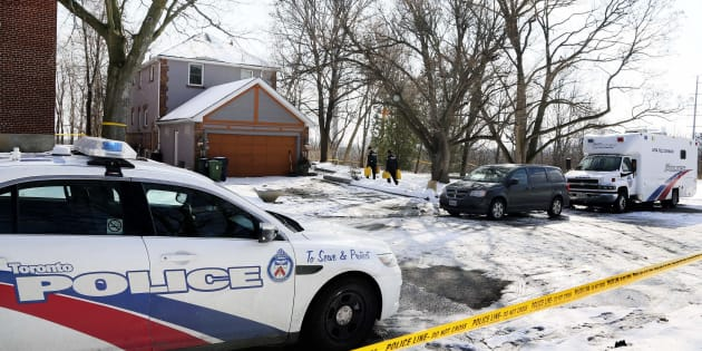 Police carry cans of fuel for investigators at 53 Mallory Cres. in Toronto on Feb. 1, 2018.