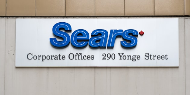 Sears sign logo at corporate offices in downtown district.