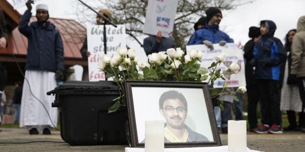 A photo of Srinivas Kuchibhotla, the 32-year-old Indian engineer killed at a bar in Olathe, Kansas, is pictured during a peace vigil in Bellevue, Washington on March 5, 2017.