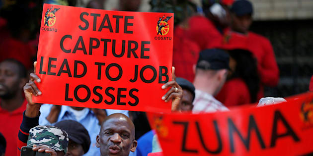 Protesters attend a demonstration organised by Cosatu in Johannesburg, South Africa, September 27, 2017.