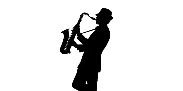 One person playing a tenor saxophone