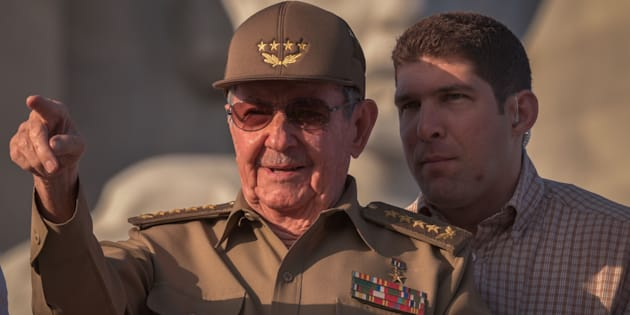 Cuban President Raul Castro, next to his grandson and bodyguard, Raul Rodriguez Castro