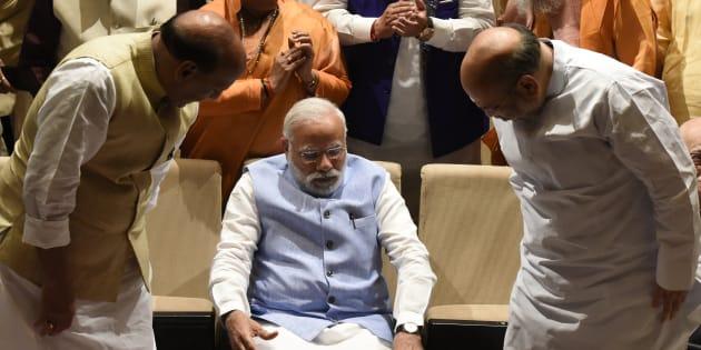 BJP president Amit Shah (R) PM Narendra Modi (C) Union Home Minister Rajnath Singh (L).