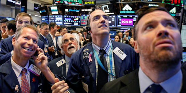 Traders watch stock prices on the floor of the New York Stock Exchange in New York Sept. 19. Canadian cannabis companies are making giant gains in the U.S. stock market ahead of legalization in Canada next month