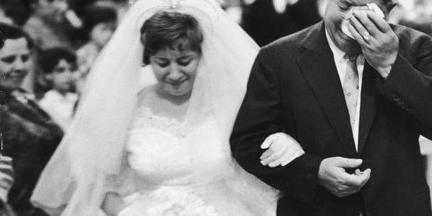 An emotional Italian father weeping as he walks his daughter down the aisle.