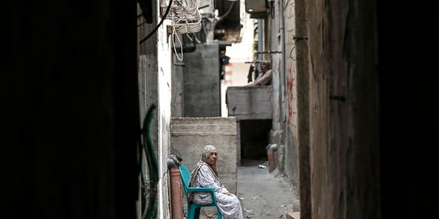 A Palestinian refugee sits in a street of the Al-Shati refugee camp, in Gaza City on September 1, 2018.