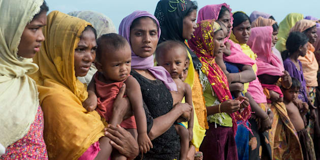 Women hold children at a makeshift camp in Rakhine state in Myanmar.