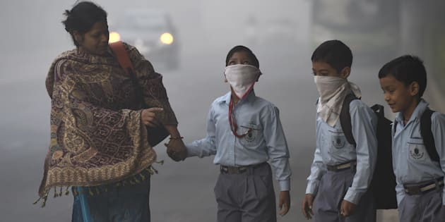 School children taking precautions as city covered under a blanket of heavy smog, air quality deteriorated sharply overnight leading to poor visibility conditions across the city, on November 3, 2016 in New Delhi, India.