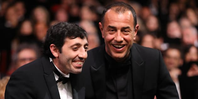 Italian actor Marcello Fonte (L) celebrates with Italian director Matteo Garrone after he was awarded with the Best Actor Prize for his part in the film 'Dogman' on May 19, 2018 during the 71st edition of the Cannes Film Festival in Cannes, southern France. (Photo by Valery HACHE / AFP)        (Photo credit should read VALERY HACHE/AFP/Getty Images)