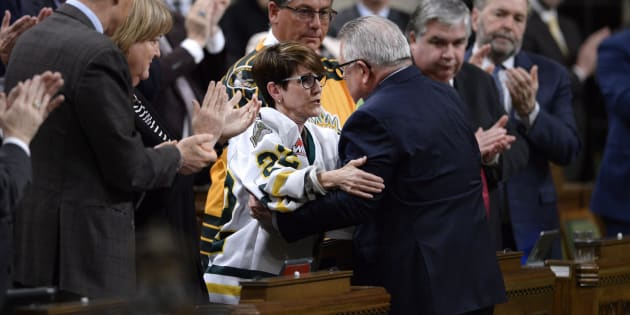 Conservative MP Kelly Block is embraced by Public Safety Minister Ralph Goodale after her statement on the Humboldt Broncos tragedy in the House of Commons on April 17, 2018.