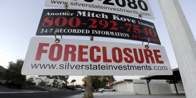 A foreclosure sign is seen in front of a bank-owned home for sale in Las Vegas, Nev., Nov. 8, 2010, in the wake of the city's housing bubble bursting. A new study finds that 40 to 50 per cent of housing booms end in a bust.