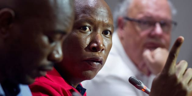 EFF leader Julius Malema flanked by DA leader Mmusi Maimane (L) and Corne Mulder (R) of the Freedom Front Plus (FF+).